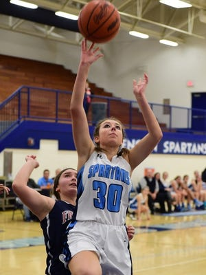 Stevenson's Kait Pence drives for a lay-up.