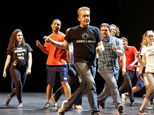 Choreographer David F. M. Vaughn directs students during