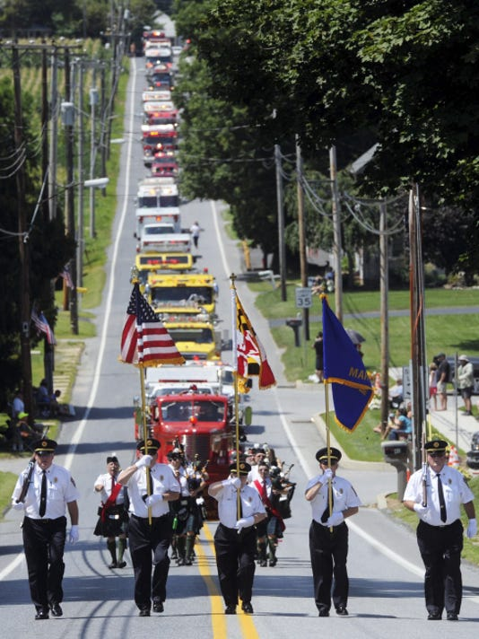 More than 50 pieces of firefighting equipment participated in the 103rd Firefighters Association of York County Convention parade.