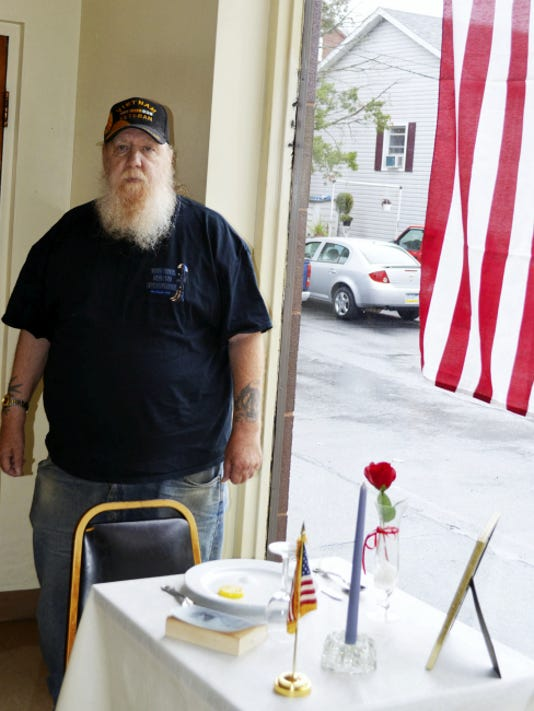 "Vietnam veteran Gary G. Johnsen, standing at the Missing Man Table at the Frederick W. Furman VFW Post 23 in Lebanon, said, ""I consider myself lucky. I didn't have to come home."""