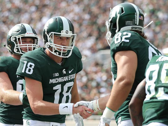 Michigan State tight end Josiah Price scores on a shirt pass and celebrates with quarterback Connor Cook during the second quarter Saturday against Central Michigan.