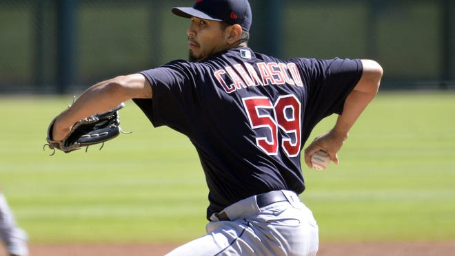 Cleveland Indians starting pitcher Carlos Carrasco throws against the Detroit Tigers in the first inning of a baseball game, Sunday, Sept. 20, 2020, in Detroit.