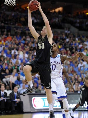 Purdue Boilermakers forward Travis Carroll (50) drives to the basket against Kansas Jayhawks forward Thomas Robinson (0) during the first half in the third round of the 2012 NCAA men's basketball tournament at the CenturyLink Center.