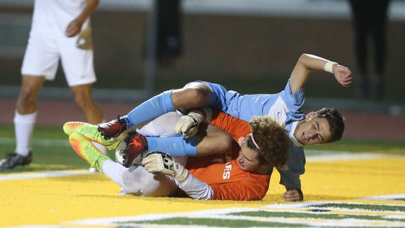 Rye Neck's Spencer Goldberg (7) collides with Briarcliff goalie Andrew Kanovsky (1) in the boys Class B soccer finals at Lakeland High School in Shrub Oak on Saturday, October 28, 2017. Rye Neck won 1-0 in overtime.
