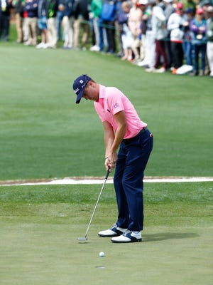 Justin Thomas putts on the 2nd green during the first round of The Masters golf tournament at Augusta National Golf Club.