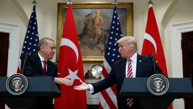 President Donald Trump shakes hands with Turkish President Recep Tayyip Erdogan in the Roosevelt Room of the White House Tuesday.  Trump pressed Erdogan for the release of Andrew Brunson, a missionary with ties to Black Mountain, during their meeting.