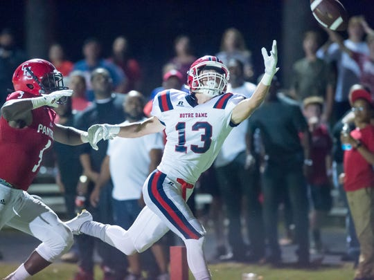 Wide Receiver Landon Meche reaches for a pass as Catholic High New Iberia takes on Notre Dame. November 4, 2016.