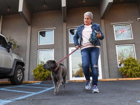 Bo Greene of Greer walks her dog Luna out of The Community
