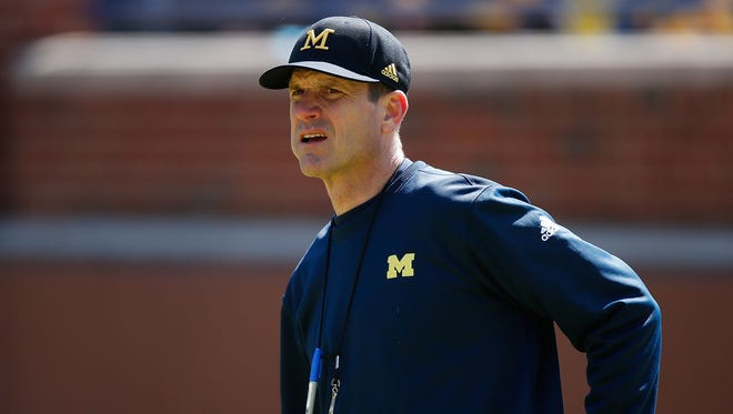 Michigan football coach Jim Harbaugh looks on during the spring game April 4, 2015m in Ann Arbor.
