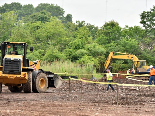 Crews work on cleaning up an area of the former Pfister Chemical site in Ridgefield in 2016. Pfister Chemical, a former dye manufacturer, closed in 2002, leaving a 19-acre site with soil contamination and vacant, dilapidated buildings.