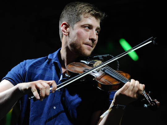 The Felice Brothers fiddle player Greg Farley performs at June's Big Barrel Country Music Festival.