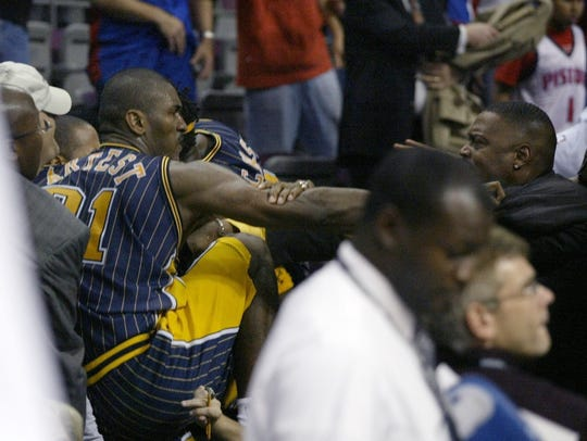 Indiana Pacers forward Ron Artest goes into the stands