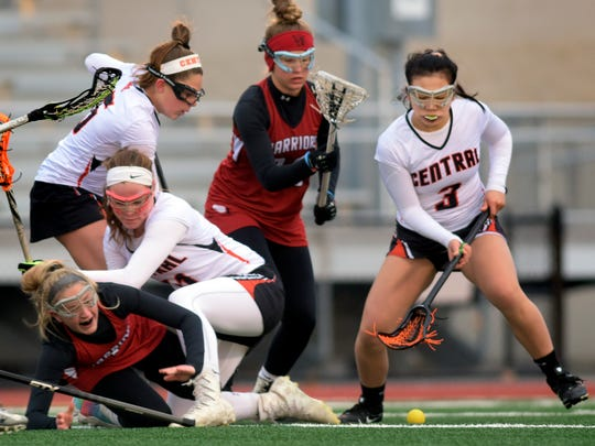 Central's Maggie Wineka, right, drives for a loose