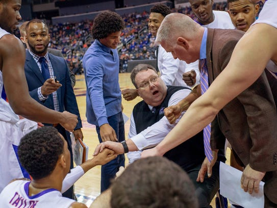 Evansville head coach Marty Simmons gathers his team