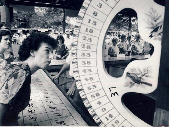 Karen Ebersold kept a close watch on the spin of the wheel while trying to win some pastry at the St. Joseph's Catholic Orphan Society Picnic on Frankfort Avenue, Aug. 8, 1981.