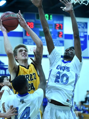 Galena's Zachary Williams shoots over McQueen's Octavian Corley in the third quarter of Thursday's game at McQueen.