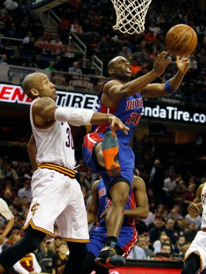 Dahntay Jones of the Cleveland Cavaliers defends Jodie Meeks, right, of the Detroit Pistons during the second half April 13, 2016 in Cleveland, Ohio.