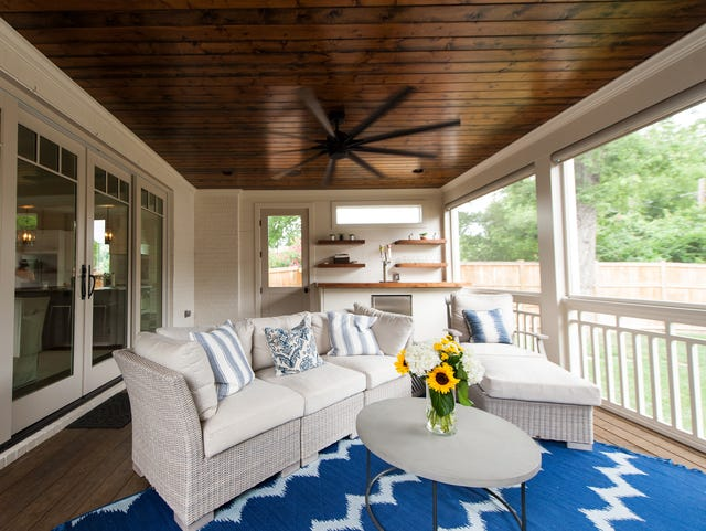 Morgan Ribeiro's porch features comfortable outdoor furniture, a fan to keep things cool and sliding doors that open the interior of the house to the outdoors.