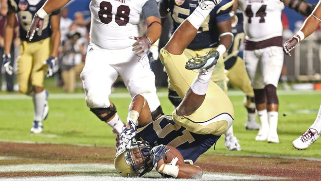 MIAMI GARDENS, FL - DECEMBER 31:  Synjyn Days #10 of the Georgia Tech Yellow Jackets scores a touchdown during the second half of the Capital One Orange Bowl game against the Mississippi State Bulldogs at Sun Life Stadium on December 31, 2014 in Miami Gardens, Florida.  (Photo by Marc Serota/Getty Images)