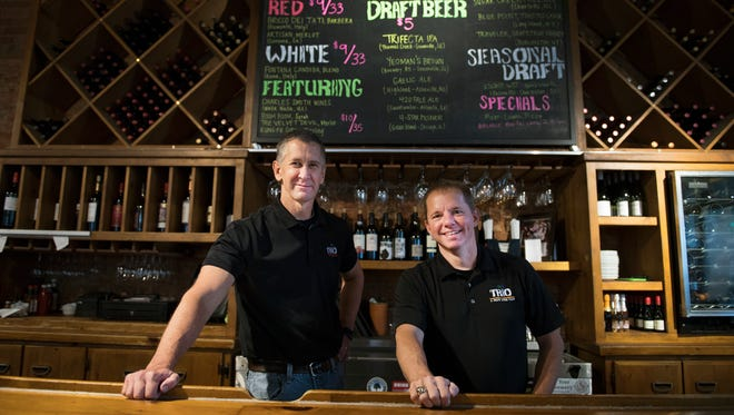 Steve Boone and Kip Wynne, co-owners of Trio, are pictured at their restaurant on Wednesday, August 3, 2016.