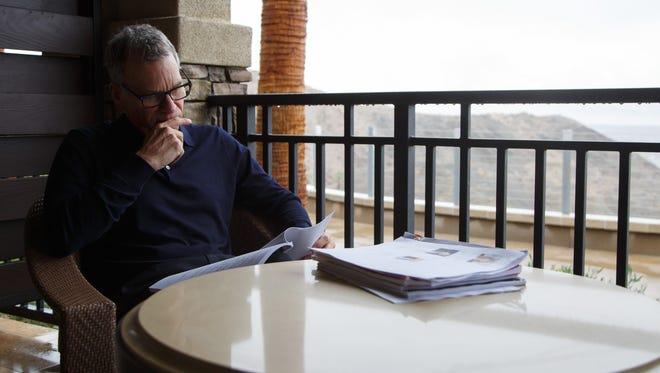 Producer David Permut reads through scripts in Rancho Mirage, Calif., Thursday, Dec. 22, 2016.
