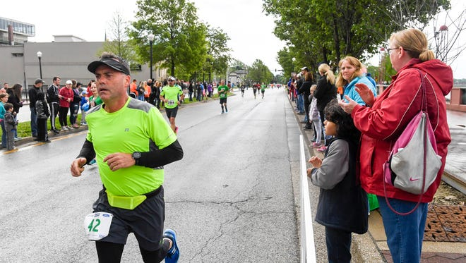 Runners near the finish line in the 2017 River Run Saturday, May 6, 2017.