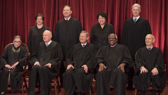 All nine Supreme Court Justices pose for a group photo