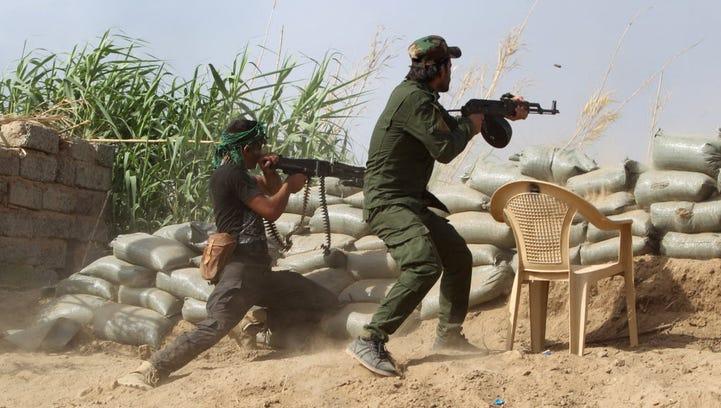 Iraqi Sunni fighters battle Islamic State fighters