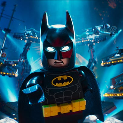 Batman (voiced by Will Arnett) deals with the characters