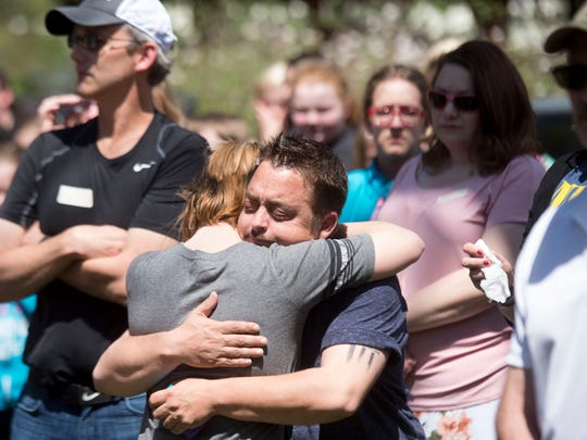 Michael Reed hugs a student at Pi Beta Phi elementary school in Gatlinburg as they celebrated Arbor Day on Wednesday, April 12, 2017, by planting a magnolia tree in honor of Reed's daughters, Chloe and Lily, who were victims in the Gatlinburg fires.