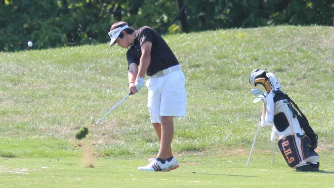 Ryle golfer Austin Squires hits the ball in 2012.