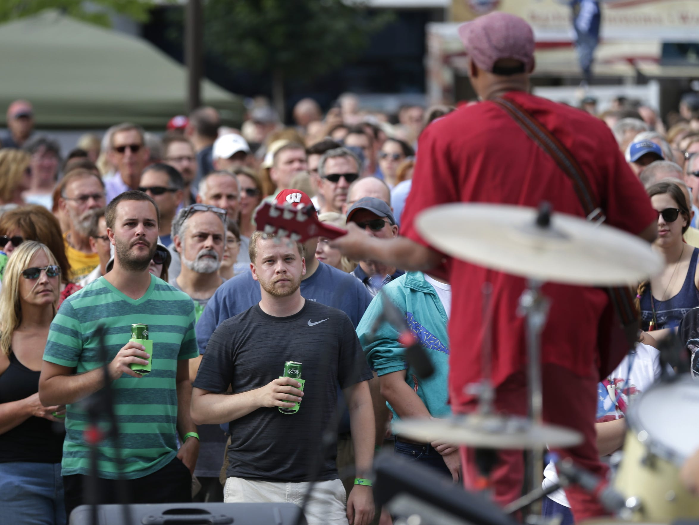 Music fans take in a show at Houdini Plaza in August