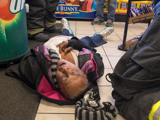 A woman, who had passed out in a convenience store,