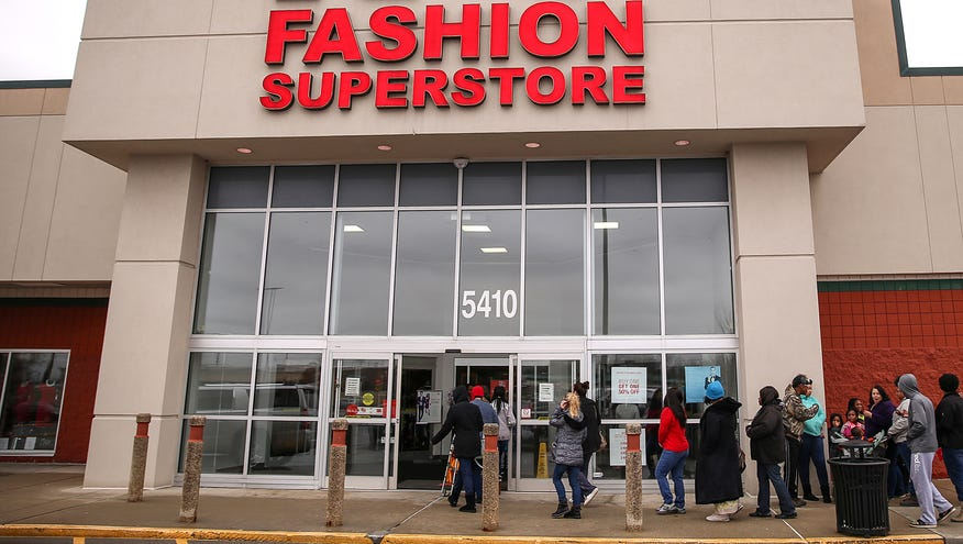f9599cd186a Women from the Ruth Lilly Women and Children s Center head into K G Fashion  Superstore in Indi…