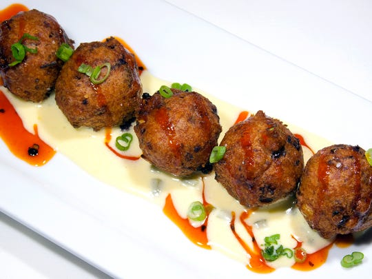 The Louisiana corn dish maque choux is turned into fritters for an appetizer at the new Edgewater Supper Club on Pewaukee Lake.