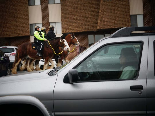 New Castle County Police mounted patrol officers search the Preserve at Deacons Walk apartments after an attempted abduction in 2017.