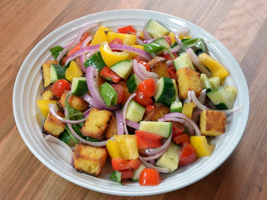 Toasted cornbread squares are tossed with summer produce