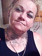 The body of Ambra Lynn Taylor, 41, was found buried in Roswell near a vacant home.