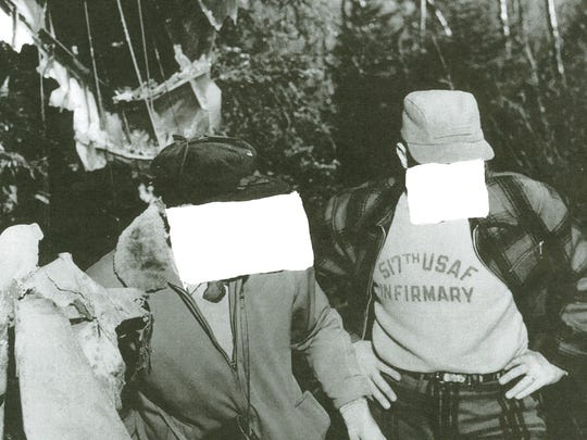 The scene of the wreckage of Army L-20 Beaver in October of 1967 in Chittenden. The Air Force blotted out the faces of these two men before sending the photos to Vermont authorities. The man on the left is Regional Medical Examiner Dr. William Powers of Rutland. The airman on the right remains unidentified.