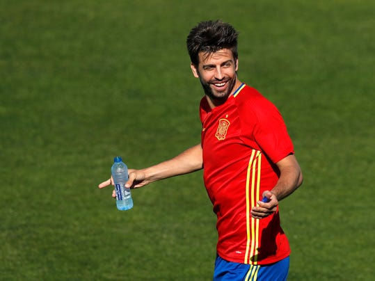 FILE- In this Friday, June 24, 2016 file photo, Spain's Gerard Pique gestures during a training session at the Sports Complex Marcel Gaillard in Saint Martin de Re in France. Spain coach Julen Lopetegui praised Gerard Pique's commitment to the national team and called on the squad to be focused only on soccer despite the crisis involving Catalonia's push for independence. (AP Photo/Manu Fernandez, File)