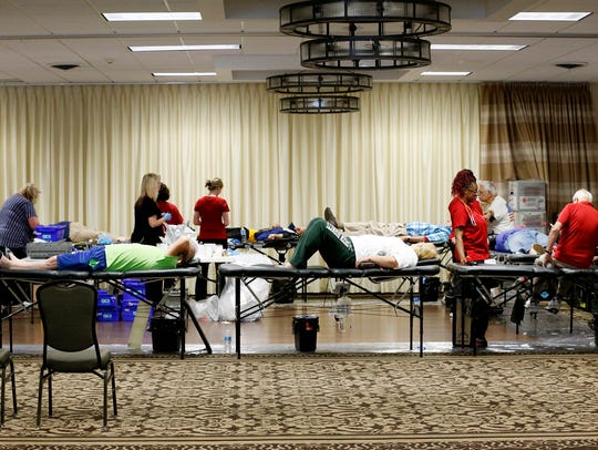 Nurses tend to the numerous blood donors Tuesday at