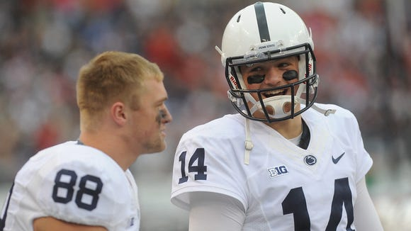 Penn State QB Christian Hackenberg, right, jokes on