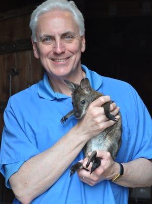 John Walczak, zoo director, with a Wallaby.