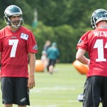 Eagles quarterback Sam Bradford, right, takes instruction from head coach Doug Pederson during Tuesday's practice.