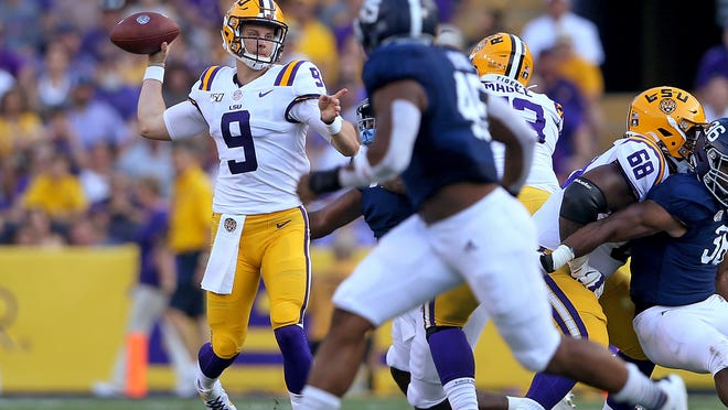LSU quarterback Joe Burrow (9) throws in the first quarter of the team's NCAA football game against Georgia Southern in Baton Rouge, La., Saturday, Aug. 31, 2019. Burrow tied an LSU single-game record with five touchdown passes before halftime. (AP Photo/Michael Democker)