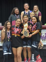 The Simon Sanchez Lady Sharks were crowned six-peat champions after finishing with 124 points at the 2017 IIAAG Girls Wrestling All-Island meet, which featured the best high school female wrestlers battling it out on the mat for a shot at getting the gold medal on Friday, Dec. 15 at the Father Duenas Phoenix Center.