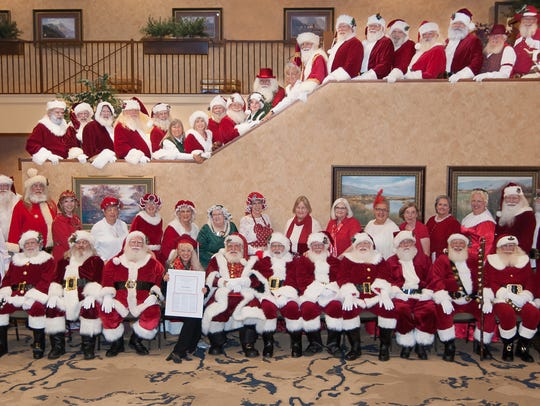 Graduates of the Professional Santa Claus School in