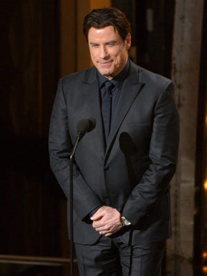 Presenter John Travolta speaks during the Oscars at the Dolby Theatre on March 2, 2014, in Los Angeles.