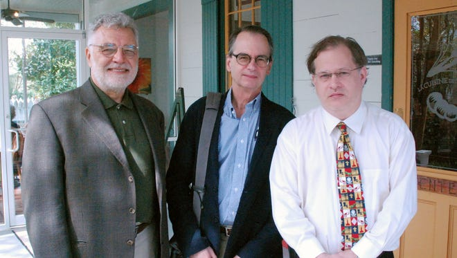 From left, John Mack Faragher, Daniel H. Usner Jr., and Shane Bernard take a break for lunch at the Path to a New Acadia symposium at Vermilionville.
