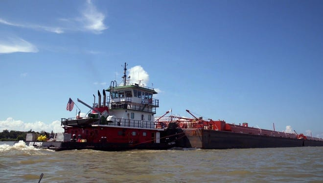 New Harmony High will be housed on a barge similar to this one on the Mississippi
